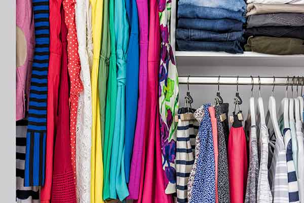 clothes organized in closet by color