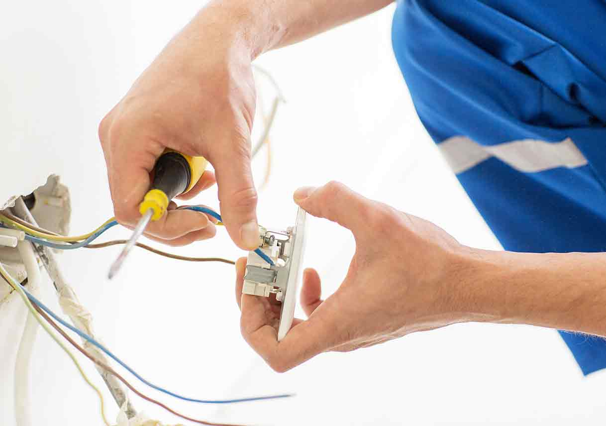 electrician fixing socket