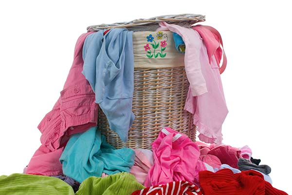 hamper full of colorful dirty laundry