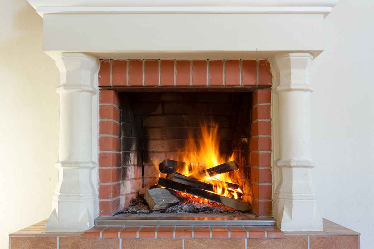 brick fireplace on white wall