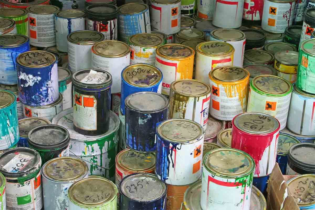 stacks of old paint cans