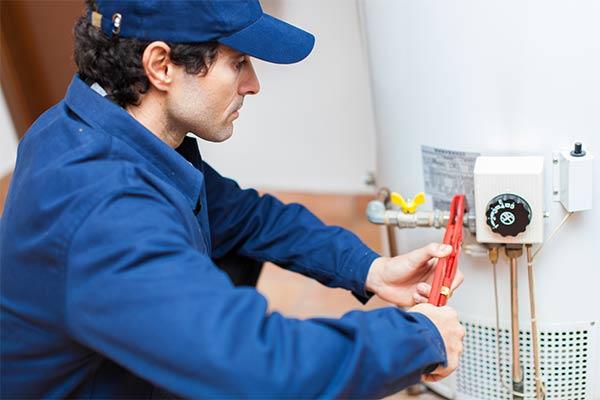 plumber fixing a hot water heater