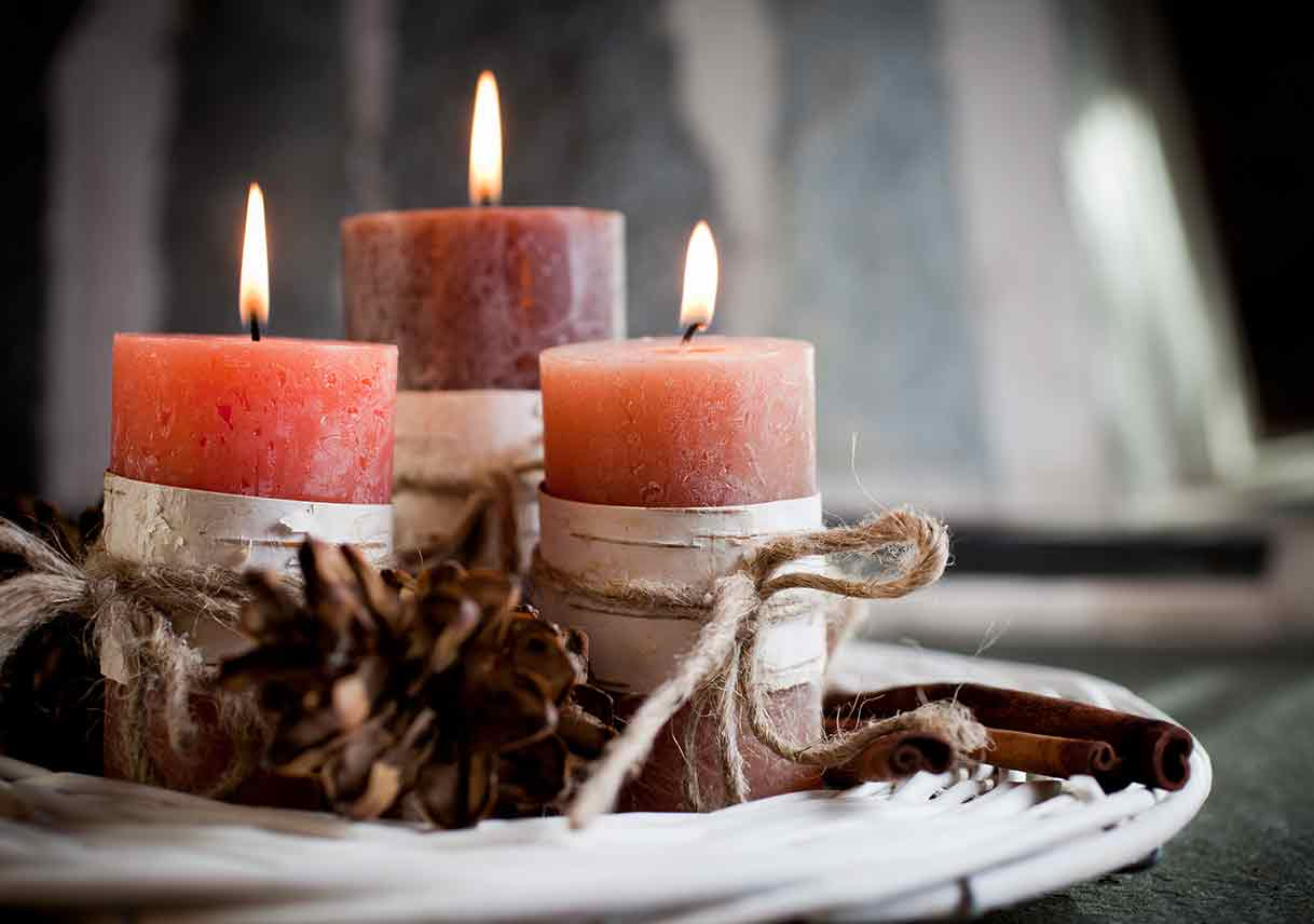 candles with autumn plants as decoration