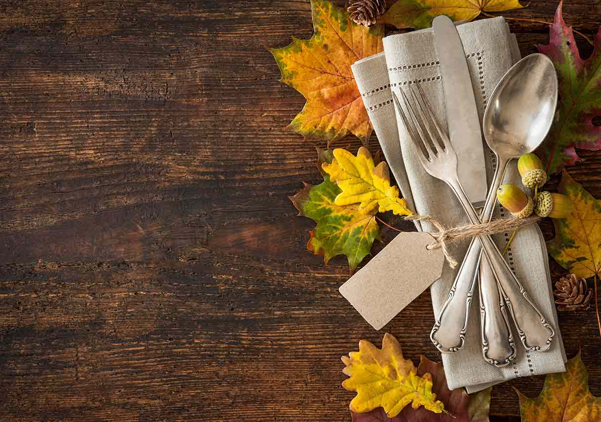 place setting on a bed of fall leaves