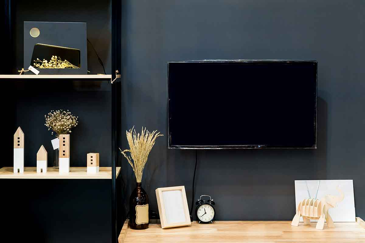 tv on a dark-colored wall