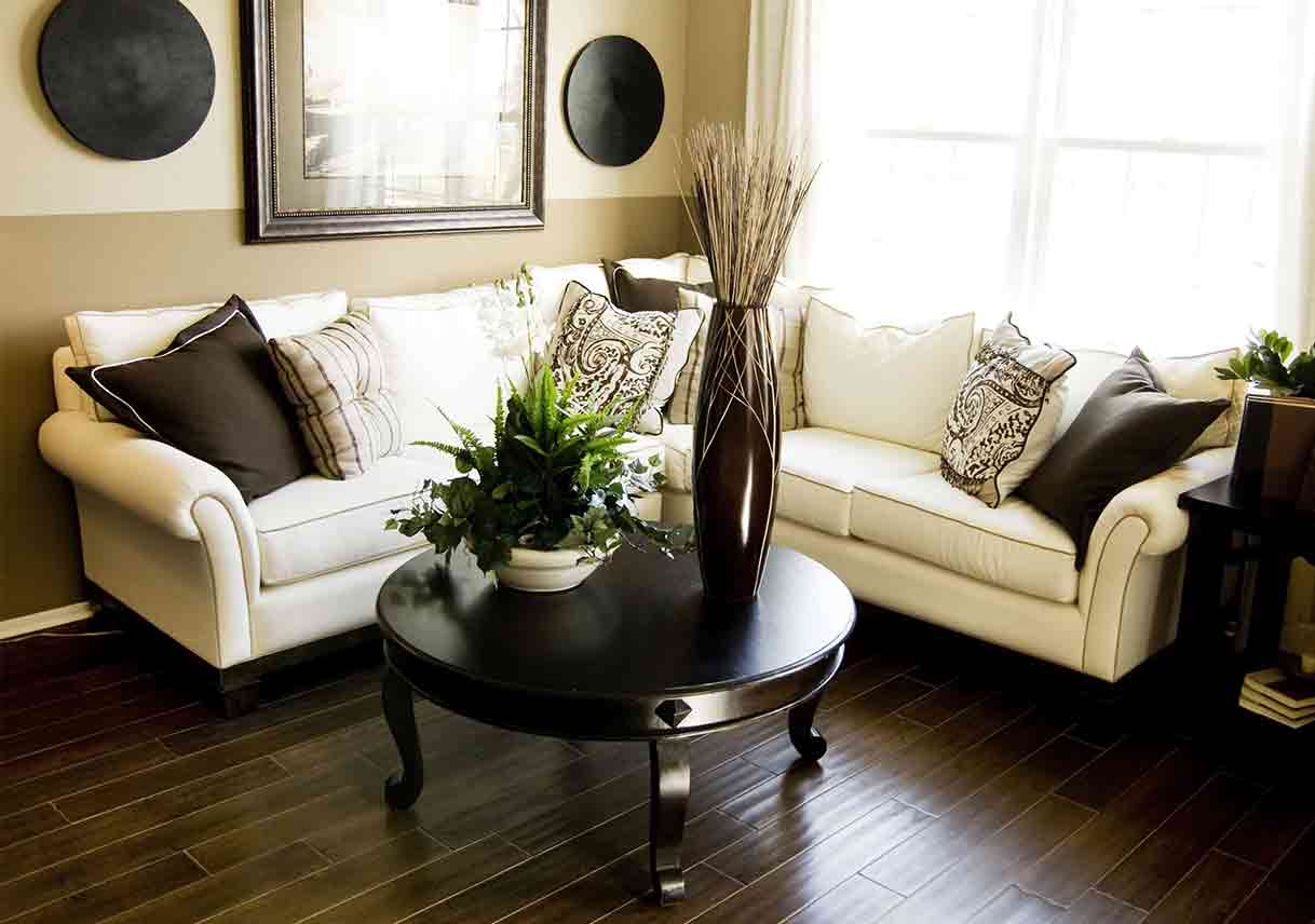 living room area with accent wall split horizontally, the top half painted beige, the bottom brown