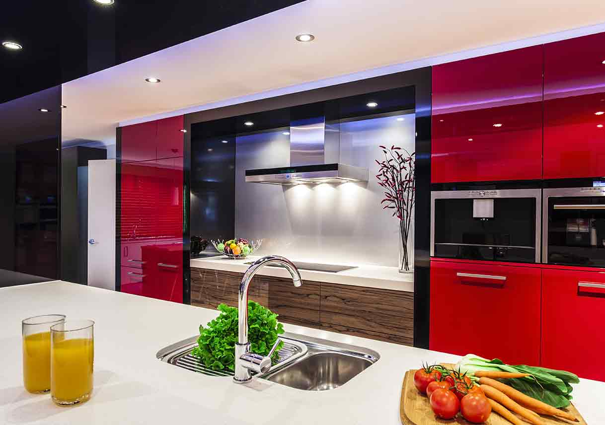 modern kitchen with glossy red cabinets and wooden detail