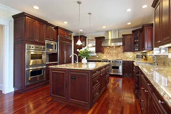 luxury kitchen with cherry wood and marble countertop