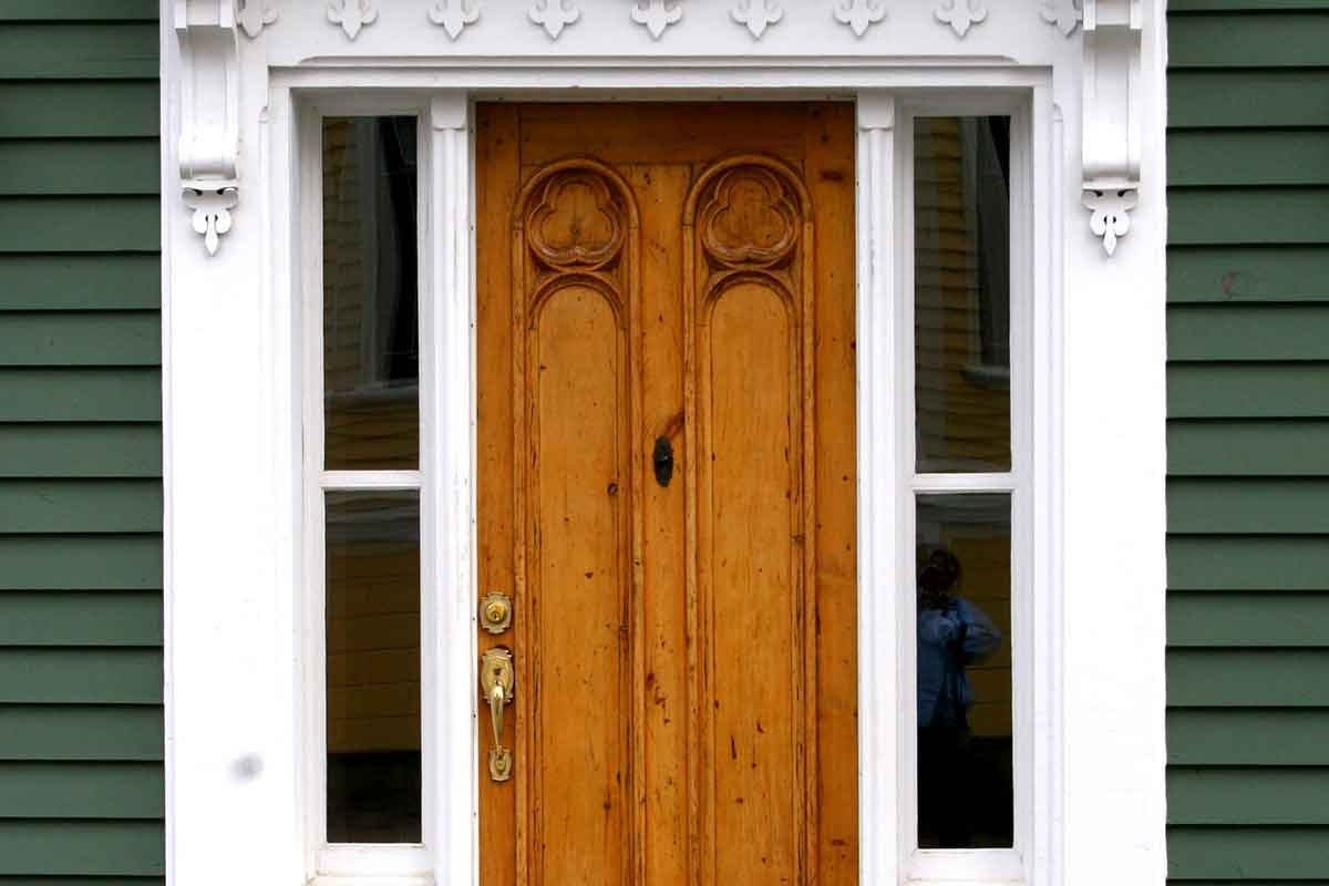 natural wood front door in historic home