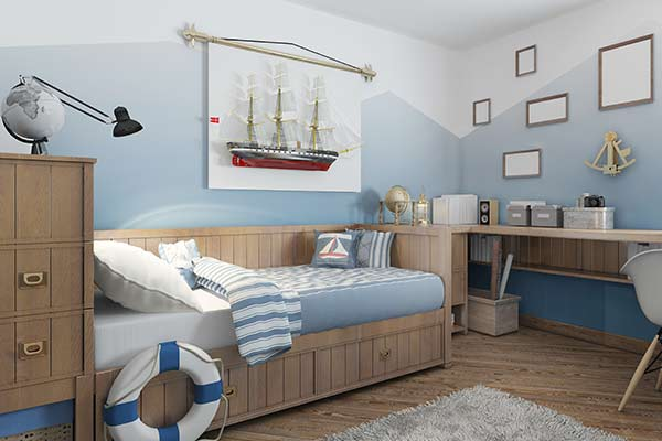 child's room with nautical themed decor