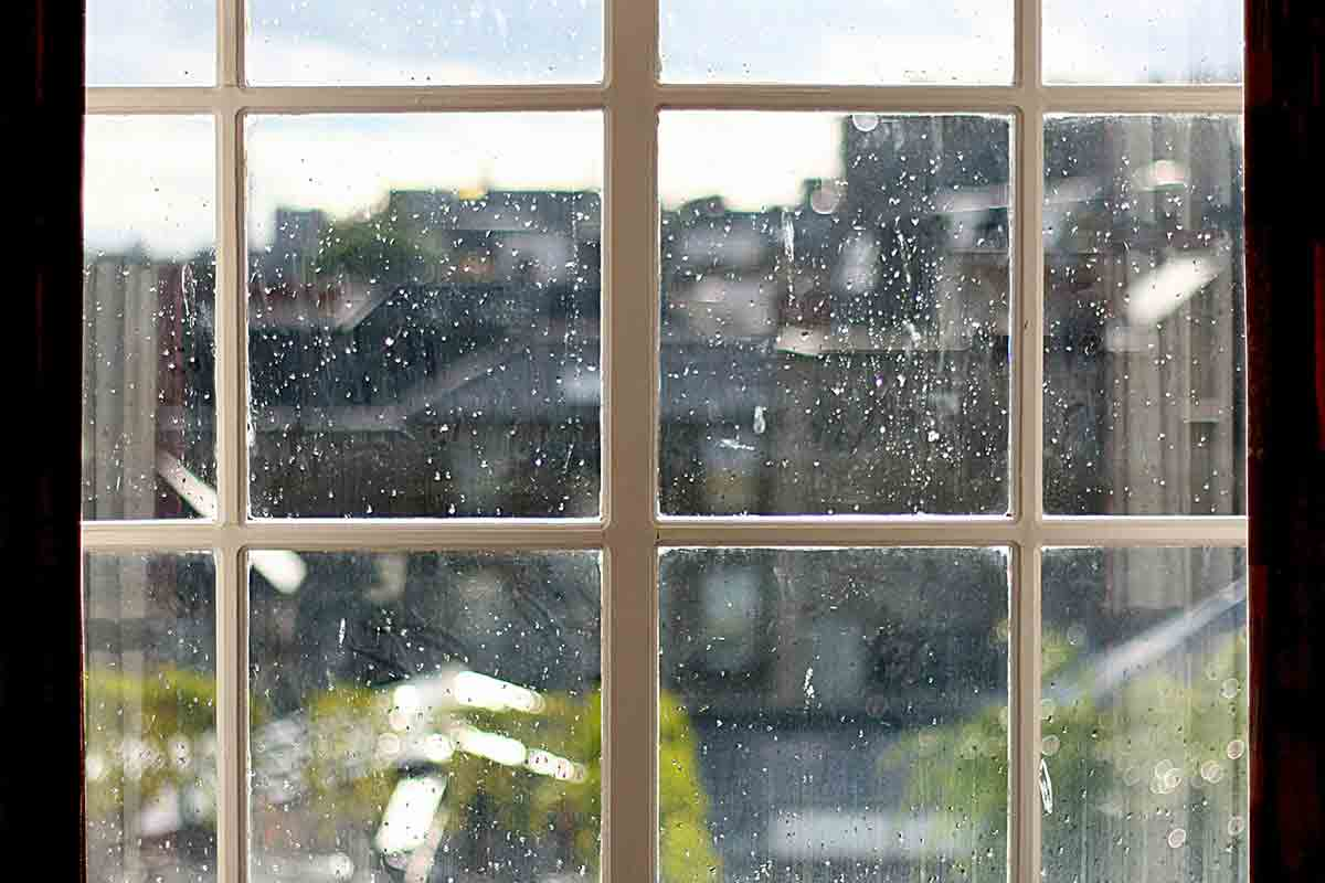 window covered in raindrops