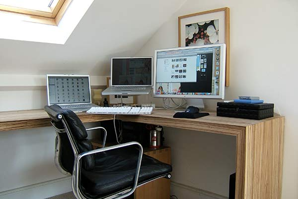 home office corner with computers
