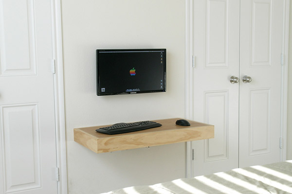 wall mounted desk with computer