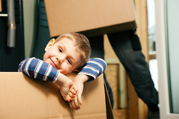 child sitting inside a moving box