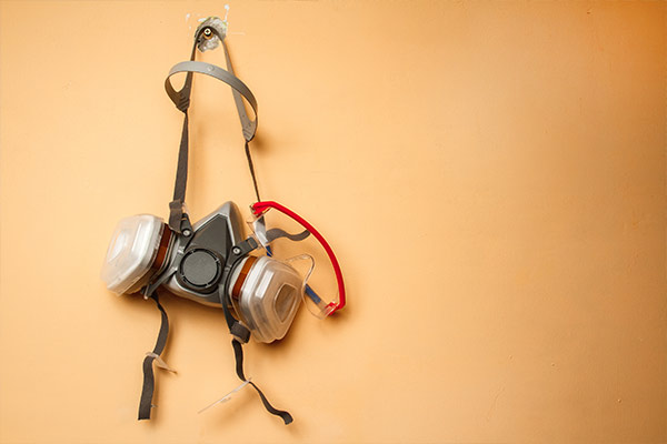 respirator mask hanging on wall