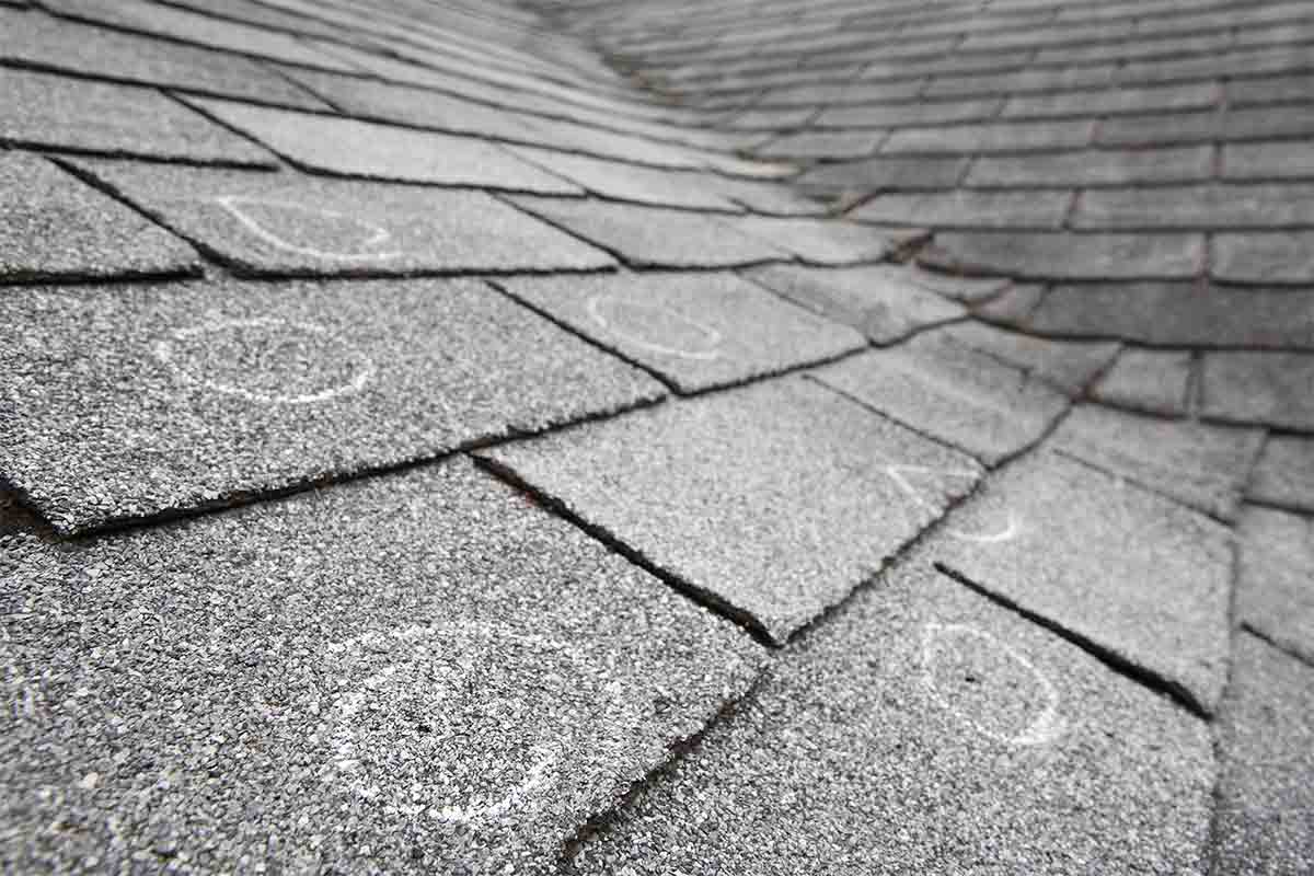 old roof with hail damage