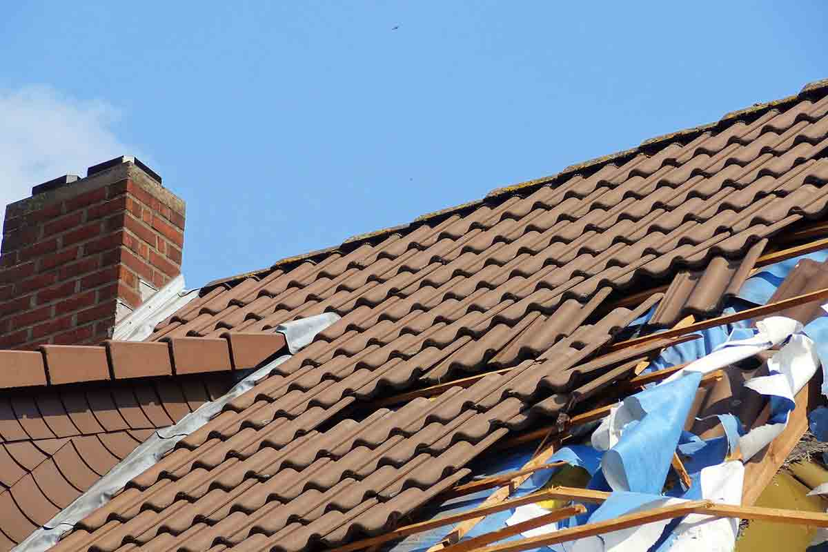 storm-damaged tile roof