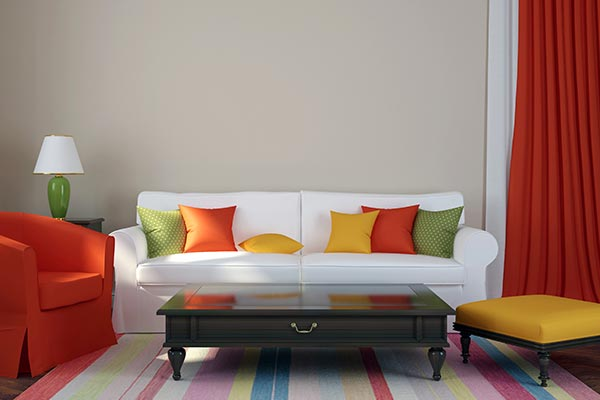 a colorful living room of green, yellow, and red