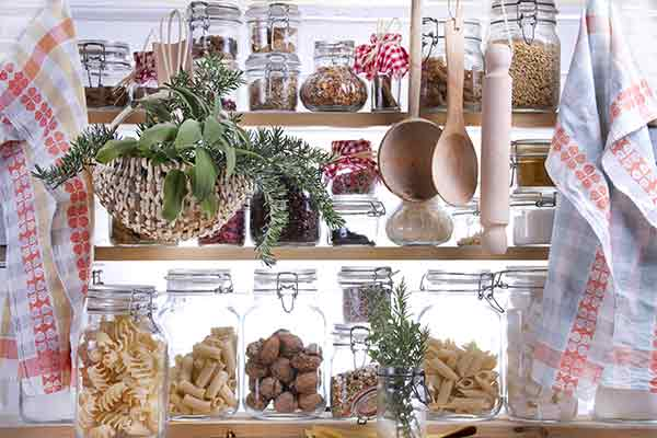 food storage jars with grains in small pantry