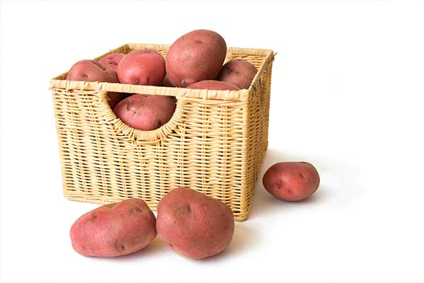 red potatoes in wicker basket