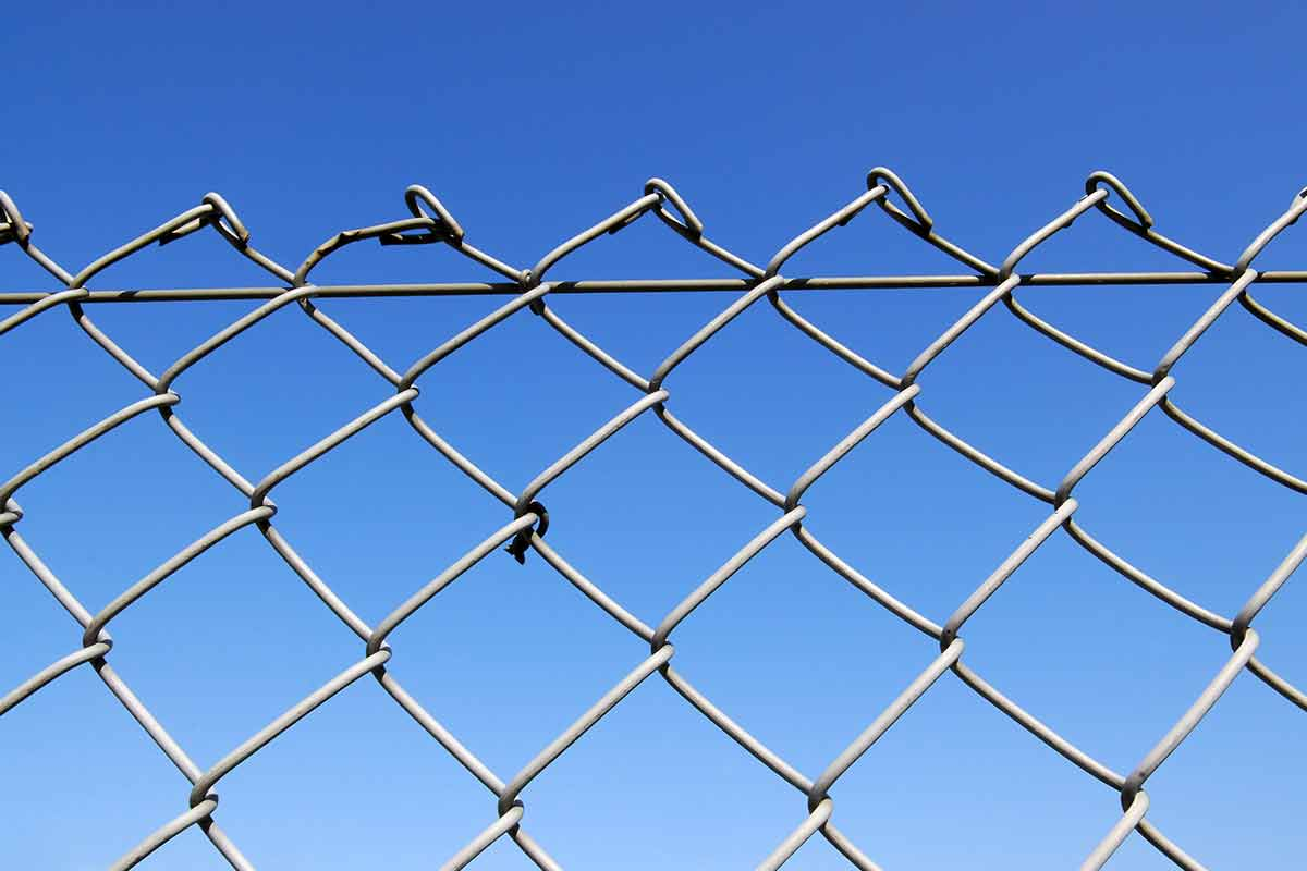 chain link fence isolated against blue sky