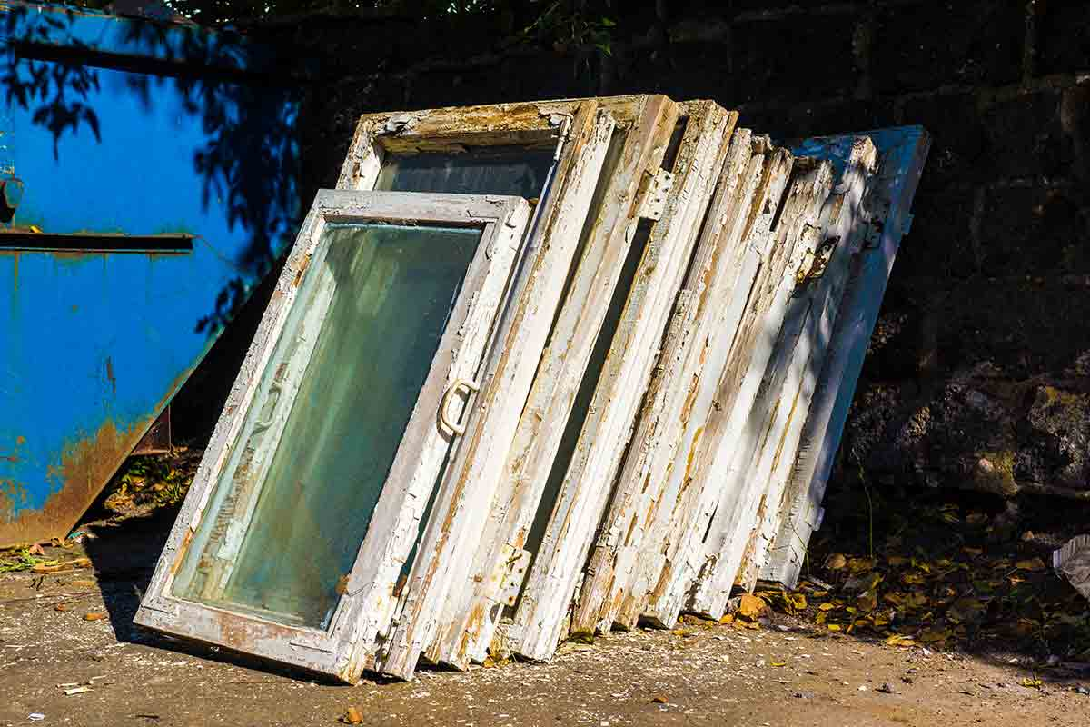 stack of old wood windows
