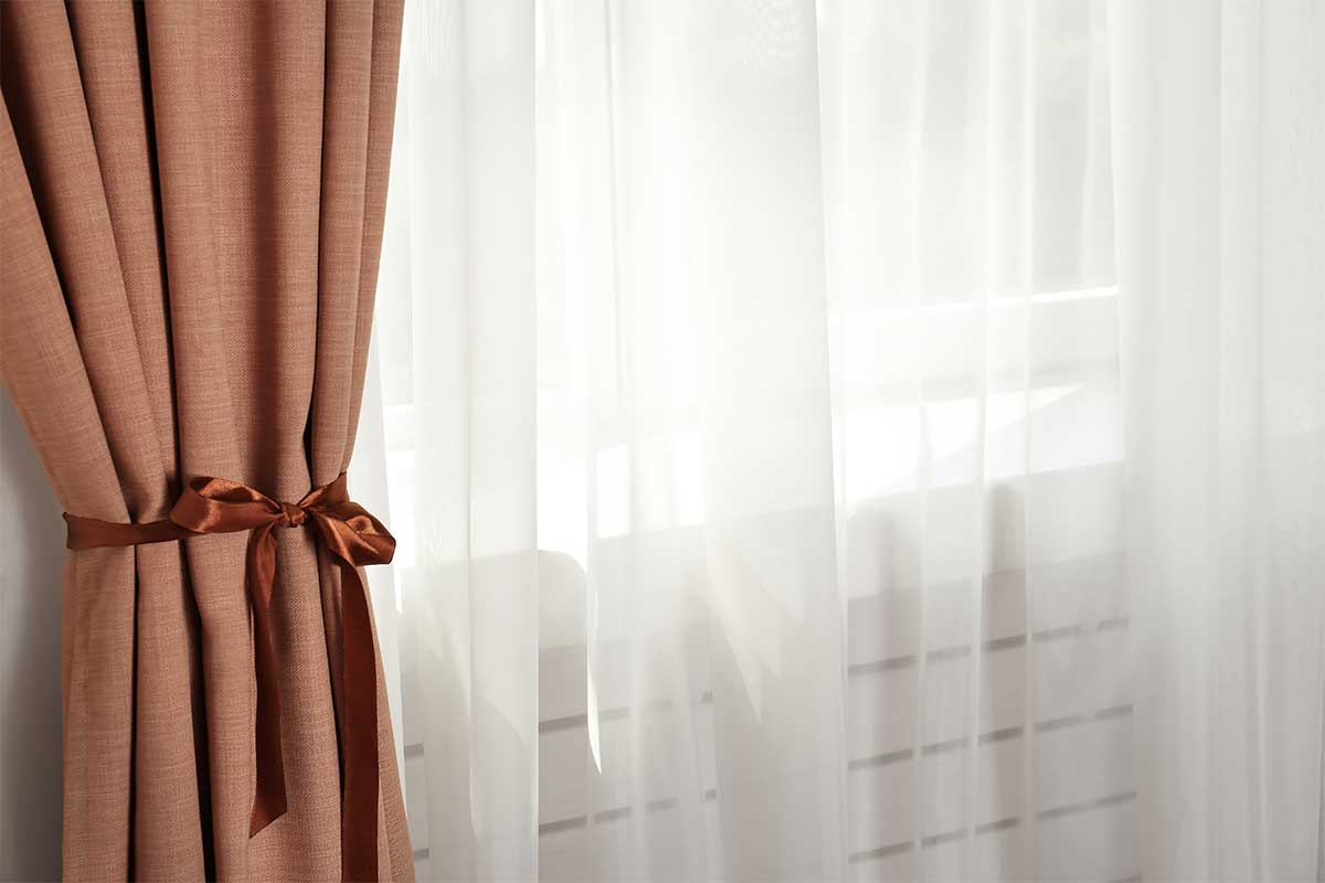 curtains tied back at window frame