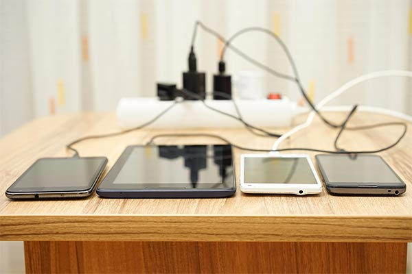 phones and tablets sit on table