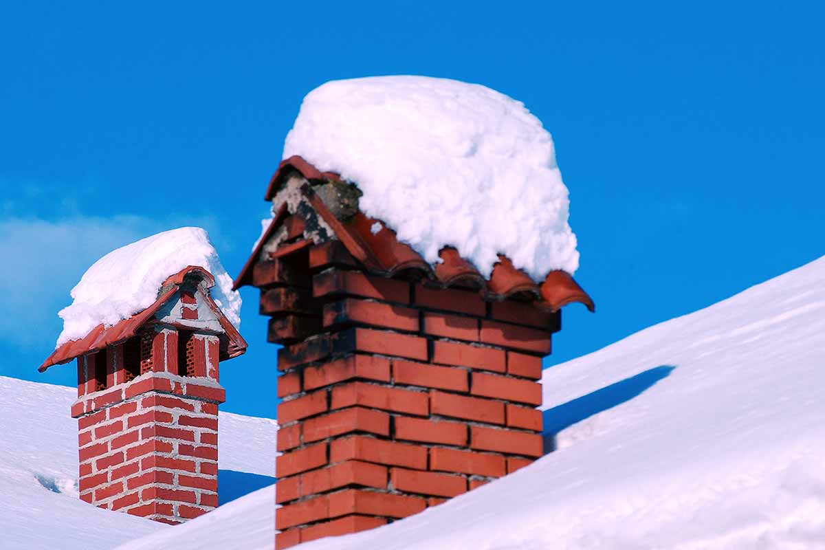 snow covered chimney caps