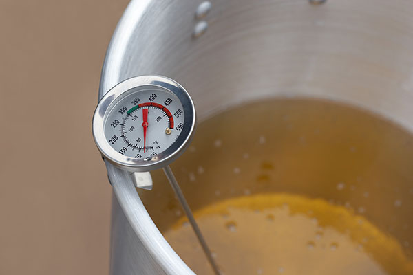 thermometer in pot of oil