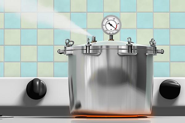 pressure cooker steaming on hot burner