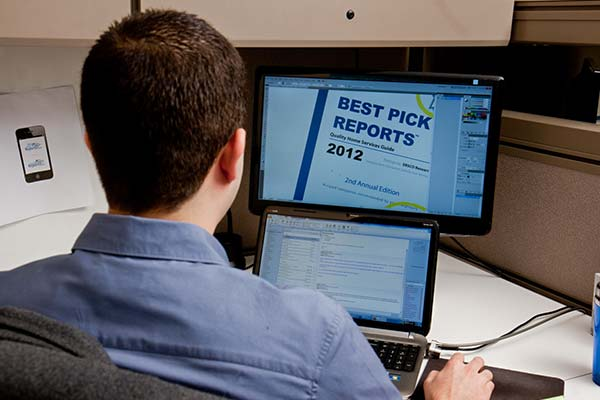 A Best Pick Reports employee helps create our publication