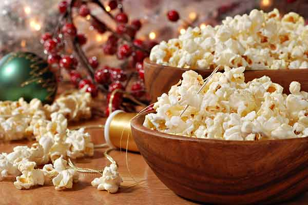 bowl of popcorn to be strung for garland