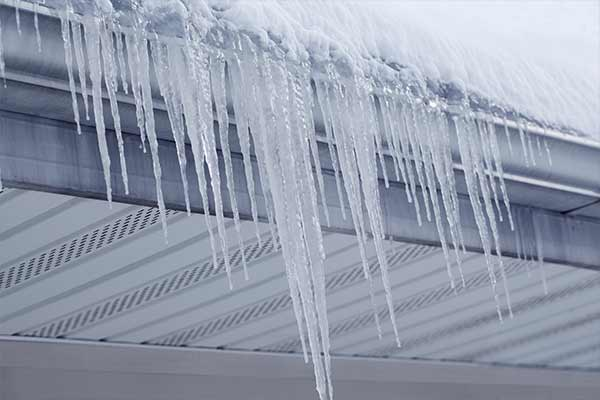 icicles dangle over house gutters