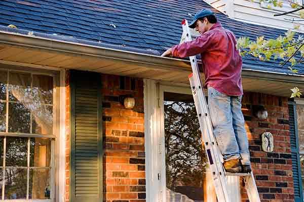 man working on gutters