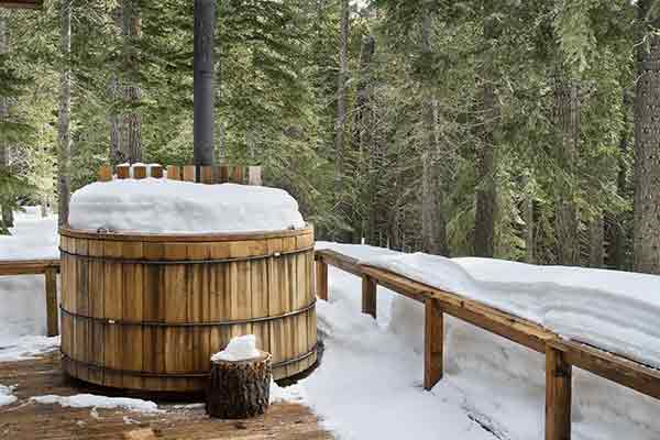 A hot tub frozen over in the cold