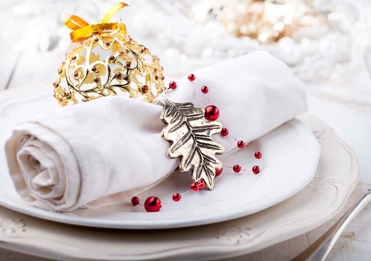 place setting decorated with leaf and ball ornaments