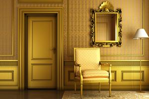 Decorative mirror with golden molding by door