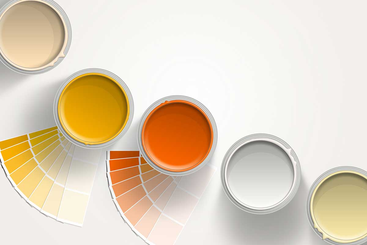 cans of yellow and orange acrylic latex paint