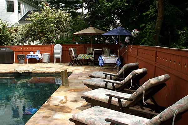 backyard pool with lounge chairs