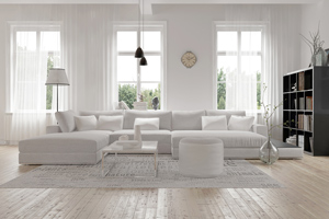 living room with white furniture and light through large windows