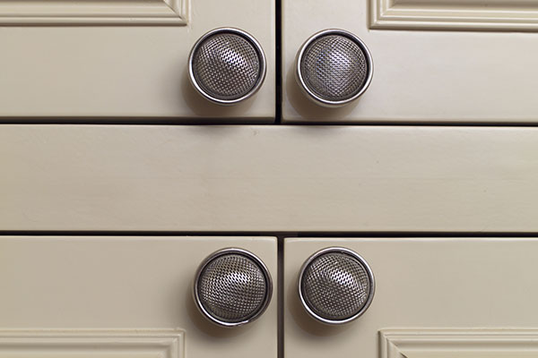 close-up photo of cabinet door handles