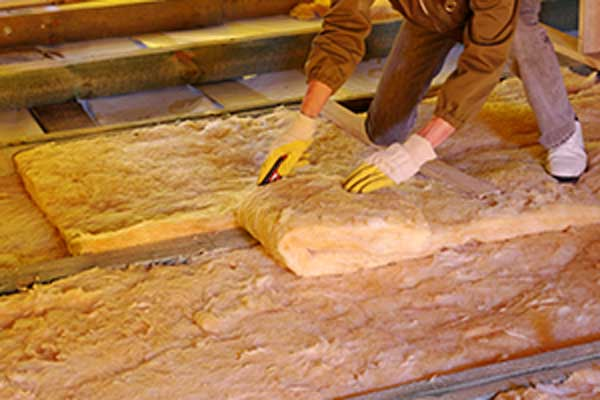 contractor installing new insulation in attic