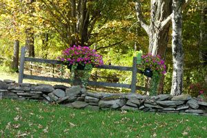 floral baskets on fence posts along path
