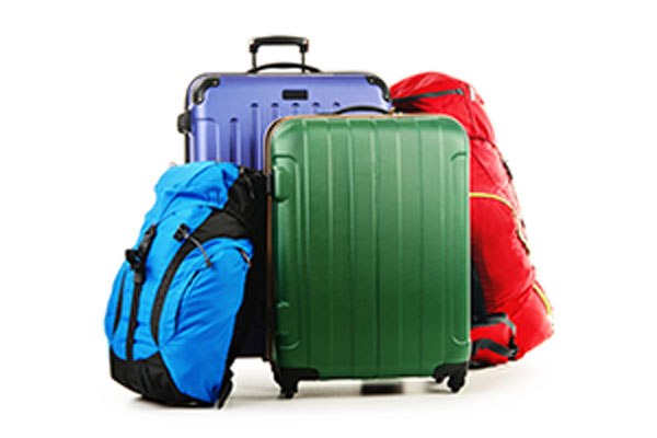 group of four packed suitcases