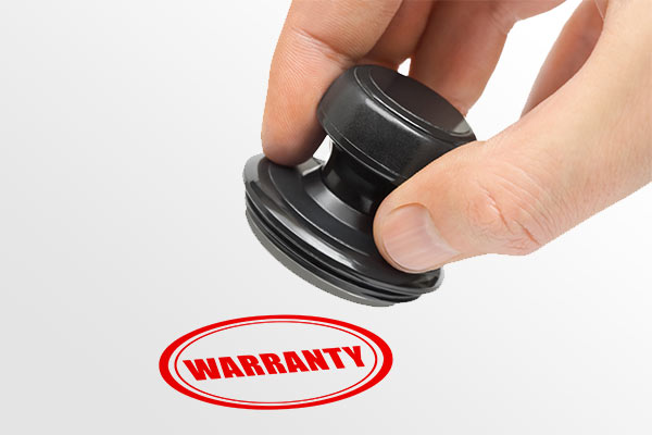 hand holding a warranty stamp