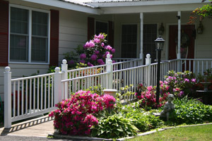 handicap ramp in front of house with flowers on sides