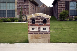 mailboxes in a brick and stone structure