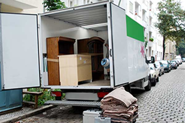 moving truck partially loaded with furniture