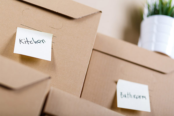 pile of boxes with room labels